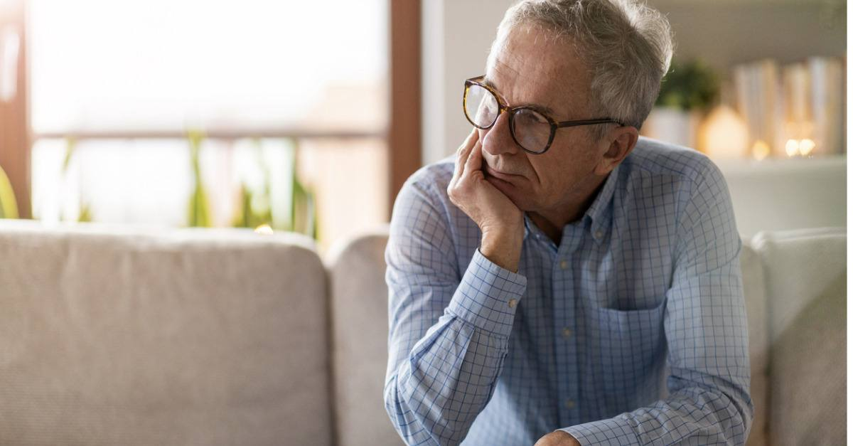 Senior male worried, thinking about his mental health.